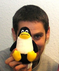 Balthas Seibold with open source penguin. Copyright: Balthas Seibold